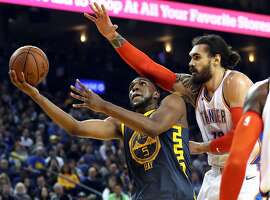 Golden State Warriors' Kevon Looney is fouled by Oklahoma City Thunder's Steven Adams in 2nd quarter during NBA game at Oracle Arena in Oakland, Calif. on Wednesday, November 21, 2018.