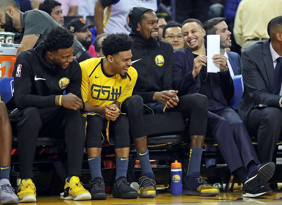 Golden State Warriors' Jordan Bell, Quinn Cook, Kevin Durant and Stephen Curry enjoy themselves in 2nd quarter against Oklahoma City Thunder during NBA game at Oracle Arena in Oakland, Calif. on Wednesday, November 21, 2018. Photo: Scott Strazzante, The Chronicle