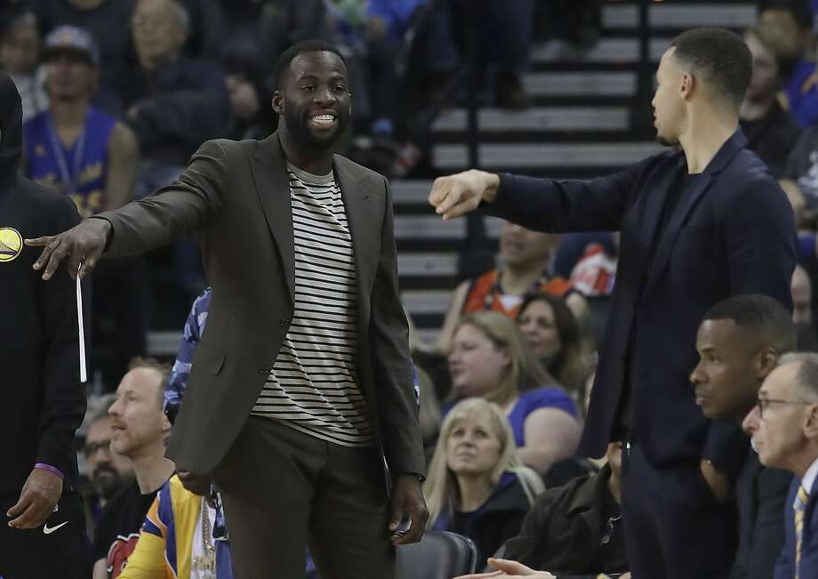 Golden State Warriors forward Draymond Green, left, and guard Stephen Curry gesture from the sideline during the first half of the team's NBA basketball game against the Oklahoma City Thunder in Oakland, Calif., Wednesday, Nov. 21, 2018. (AP Photo/Jeff Chiu) Photo: Jeff Chiu / Associated Press