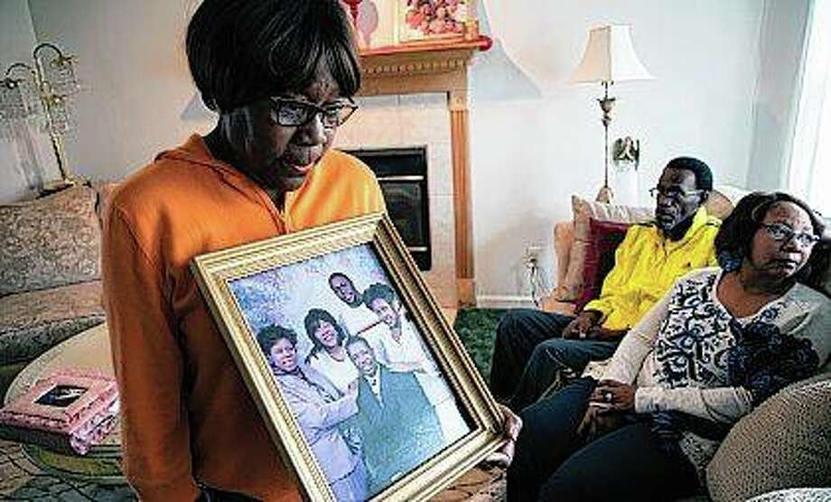 Glenda O'Neal, mother of of Dr. Tamara O'Neal, shows a photo of her family at their home in LaPorte, Indiana. Tamara was one of the three people fatally shot Monday at a Chicago hospital. Photo: Zbigniew Bzdak | Chicago Tribune (AP)