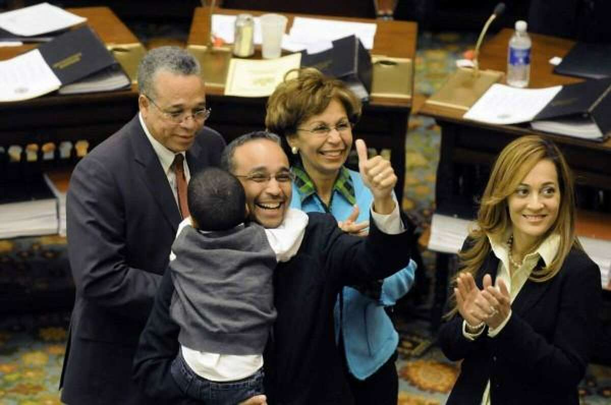 State Sen. Jose Peralta, seen giving the thumbs up, in an undated photo in the state Legislative chamber. Peralta, 47, died suddenly from septic shock Wednesday, Nov. 21, 2018.