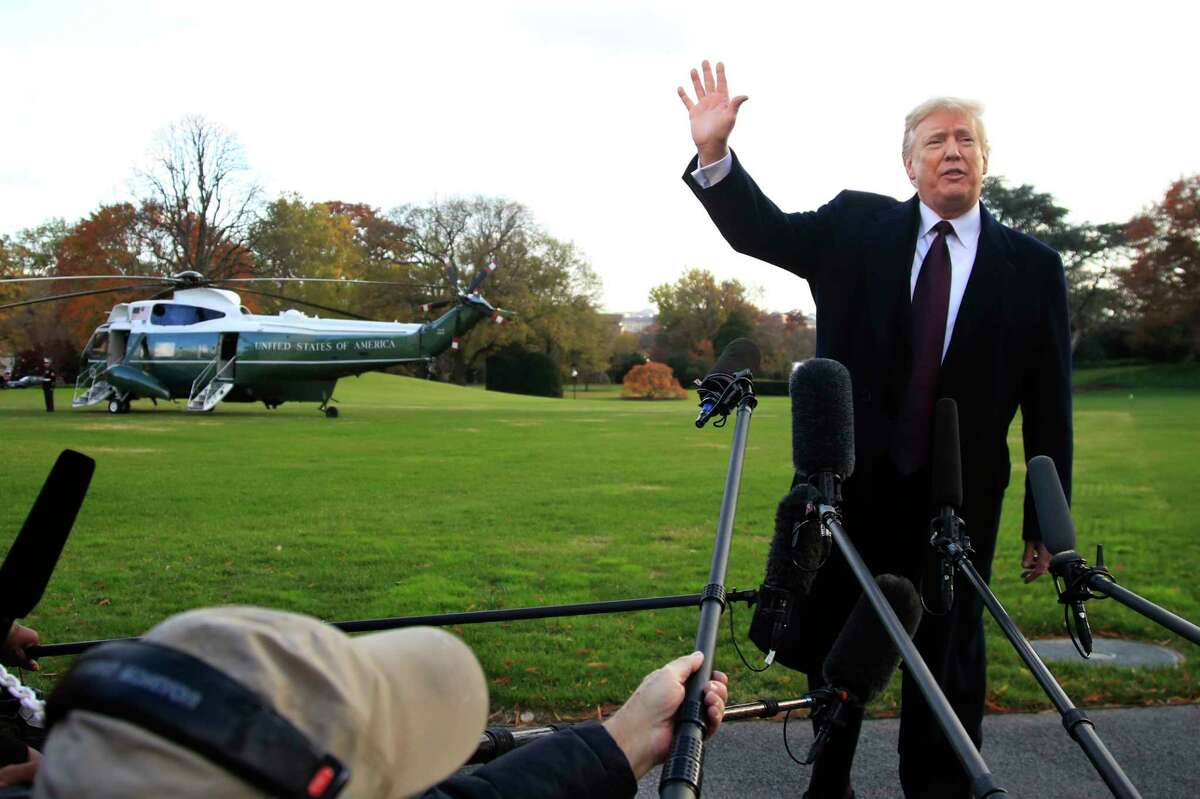 FILE- In this Tuesday, Nov. 20, 2018, file photo President Donald Trump speaks to the media before leaving the White House in Washington to travel to Florida. The Trumps are spending the Thanksgiving Day week at his Mar-a-Lago estate in Palm Beach.