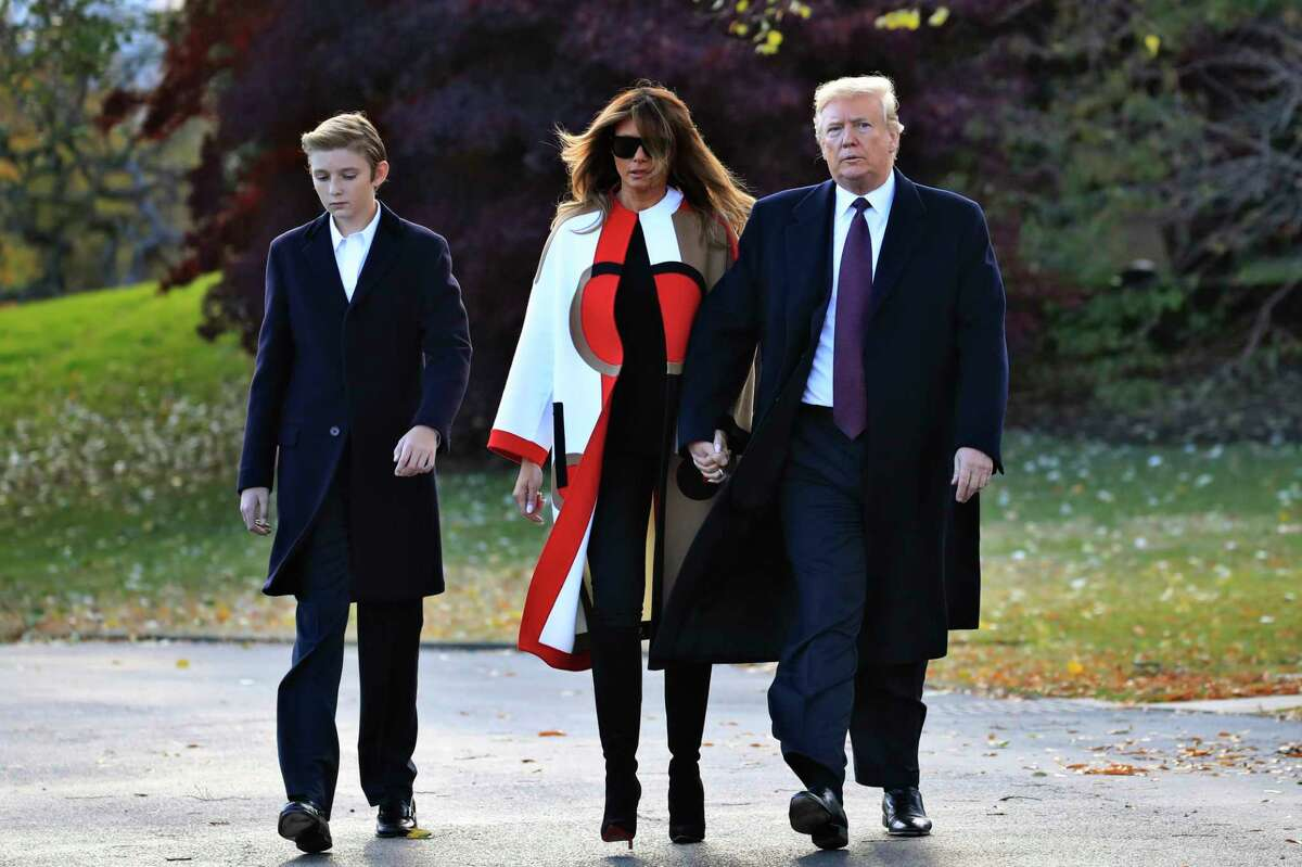 FILE- In this Tuesday, Nov. 20, 2018, file photo President Donald Trump with first lady Melania Trump and their son Barron Trump walk from the Oval Office as they leave the White House in Washington to travel to Florida. The Trumps are spending the Thanksgiving Day week at his Mar-a-Lago estate in Palm Beach.