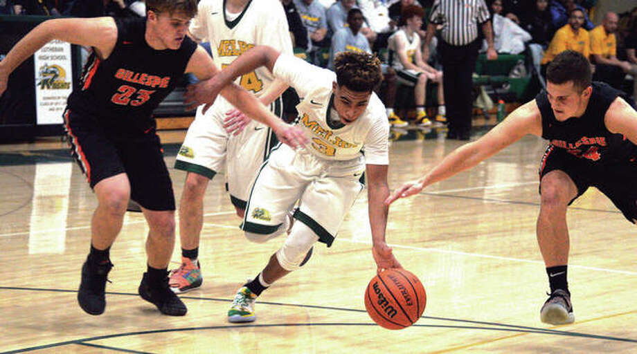 Metro-East Lutheran's Jason Williams retains possession of the ball while splitting defensive pressure from Gillespie's Frankie Barrett (left) and Anthony Kravanya (right) during Wednesday night's quarterfinal at MEL's Thanksgiving Turkey Tip-Off Tournament at Hooks Gym in Edwardsville. MEL defeated Gillespie 58-23. Photo: Scott Marion / Hearst Illinois