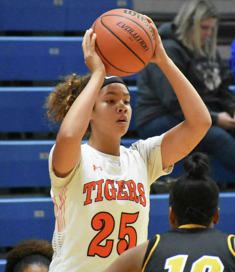 Edwardsville freshman Sydney Harris looks for a teammate during the Tigers' victory over Hazelwood Central on Wednesday at the Southern Illinois Shootout at Panther Dome in O'Fallon. Photo: Matt Kamp / Hearst Illinois