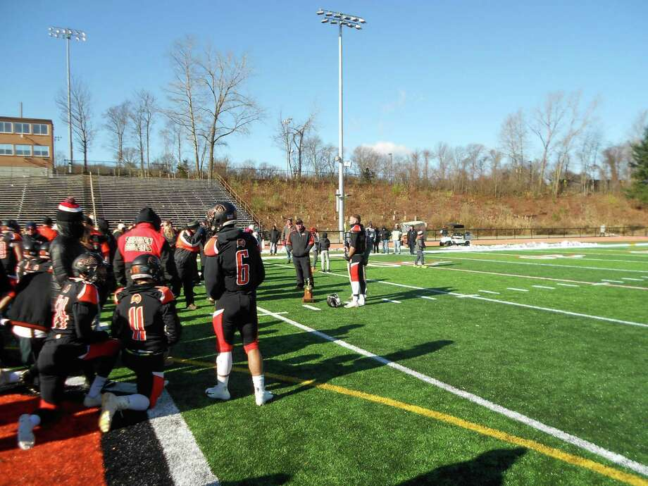 Shelton senior quarterback Jake Roberts accepts the Silver Turkey as MVP of Shelton's 62-6 win over Derby on Thursday morning at Finn Stadium Photo: Michael Fornabaio / Hearst Connecticut Media / Contributed Photo / Stamford Advocate Contributed