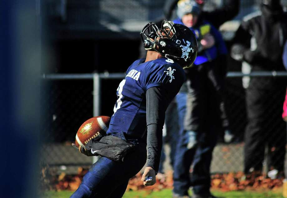 Ansonia's Shykeem Harmon (3) reacts after scoring a touchdown against Naugatuck during Thanksgiving holiday football action in Ansonia, Conn., on Thursday Nov. 22, 2018. Photo: Christian Abraham / Hearst Connecticut Media / Connecticut Post