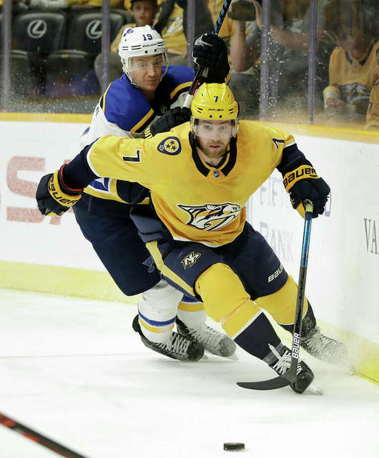 Nashville's Yannick Weber (front) and the Blues Jay Bouwmeester chase the puck in the first period Wednesday night in Nashville, Tenn. Photo: Associated Press