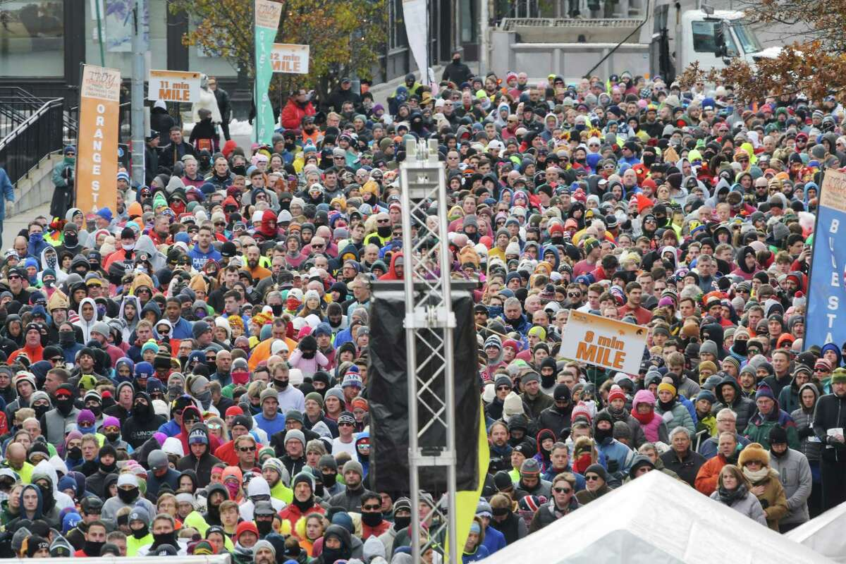 Runners gather behind the starting line as they wait for the start of the 5K race at the Troy Turkey Trot on Thursday, Nov. 22, 2018, in Troy, N.Y. (Paul Buckowski/Times Union)