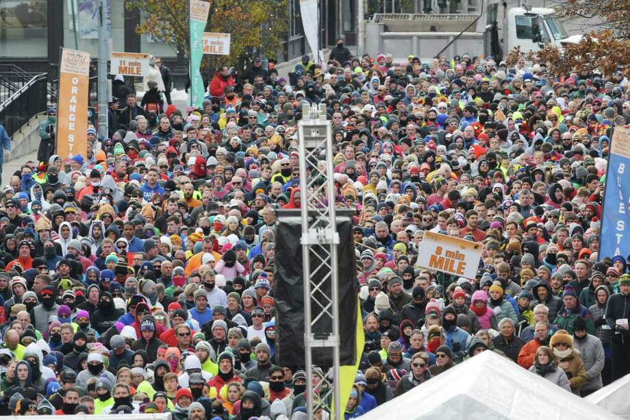 Runners gather behind the starting line as they wait for the start of the 5K race at the Troy Turkey Trot on Thursday, Nov. 22, 2018, in Troy, N.Y.  (Paul Buckowski/Times Union) Photo: Paul Buckowski, Albany Times Union / (Paul Buckowski/Times Union)