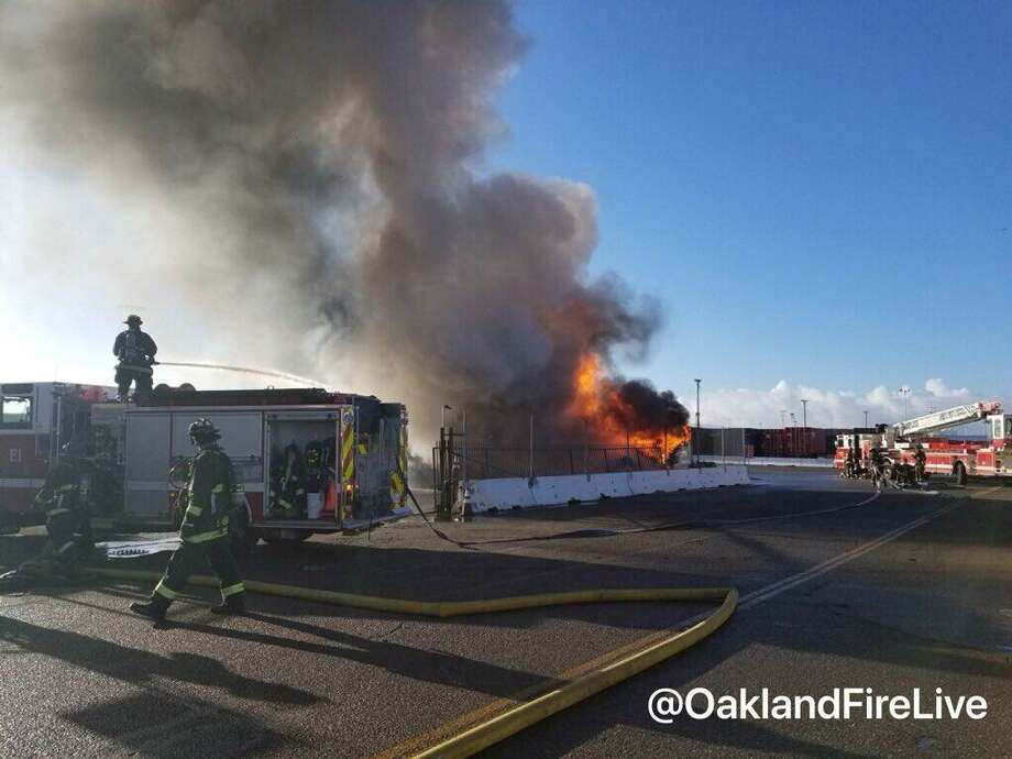 A fire burned through three big rigs and one trailer Thursday morning at the Port of Oakland. Photo: Oakland Fire Department