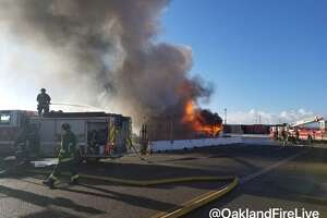 A fire burned through three big rigs and one trailer Thursday morning at the Port of Oakland.