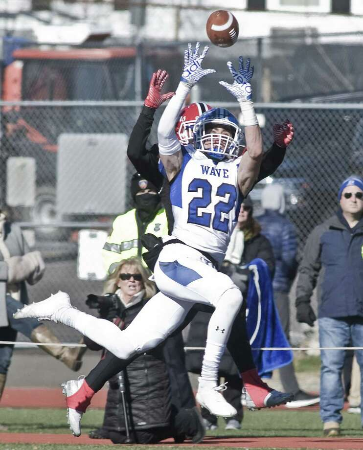 Darien High School's Jackson Peters leaps for the ball in the Thanksgiving game against New Canaan High School, played at Stamford High School. Thursday, Nov. 22, 2018 Photo: Scott Mullin / For Hearst Connecticut Media / The News-Times Freelance