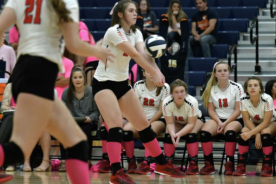 Tomball sophomore outside hitter Kate Sralla, center, makes a play against Lake Creek during their District 20-5A matchup at LCHS on Oct. 5, 2018. Photo: Jerry Baker, Houston Chronicle / Contributor / Houston Chronicle