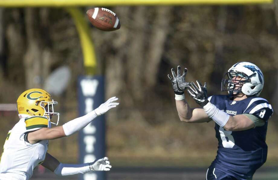 Wilton's Andrew Luciano (8) catches a pass over Trinity Catholic's defender Sam Pensiero (5) in the Thanksgiving Day football game between Trinity Catholic and Wilton high schools, Thursday, November 22, 2018, at Wilton High School, in Wilton, Conn. Photo: H John Voorhees III / Hearst Connecticut Media / The News-Times