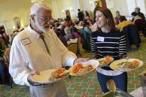 Church volunteers Carl Mecky and Beth Miranda fill plates with turkey and fixins to be served at the 21st annual Thanksgiving dinner at First Presbyterian Church in Greenwich, Conn. Thursday, Nov. 22, 2018. About 140 Greenwich seniors dined together for a filling Thanksgiving meal served by church volunteers.