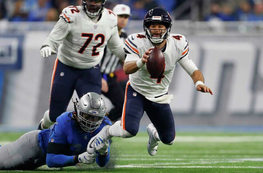 Detroit Lions defensive end Ezekiel Ansah stops Chicago Bears quarterback Chase Daniel (4) during the second half of an NFL football game, Thursday, Nov. 22, 2018, in Detroit. (AP Photo/Paul Sancya) Photo: Paul Sancya, Associated Press / Copyright 2018 The Associated Press. All rights reserved.