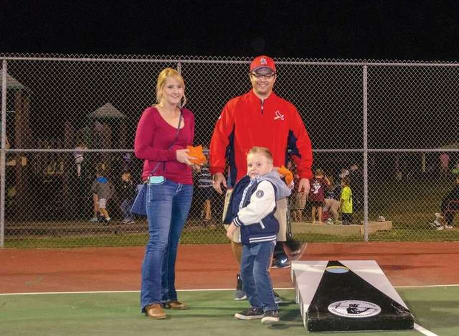 Justin Kowalis (right) and Lauren Sloan of Glen Carbon play cornhole with Jackson Clere, 4, at Miner Park during the this year's GlenFest. The success of GlenFest and the Glen Carbon Homecoming have resulted in positive fund balances for the Community Events Committee, reported at the Village Board meeting Tuesday. Photo: Matt Winte | For The Telegraph