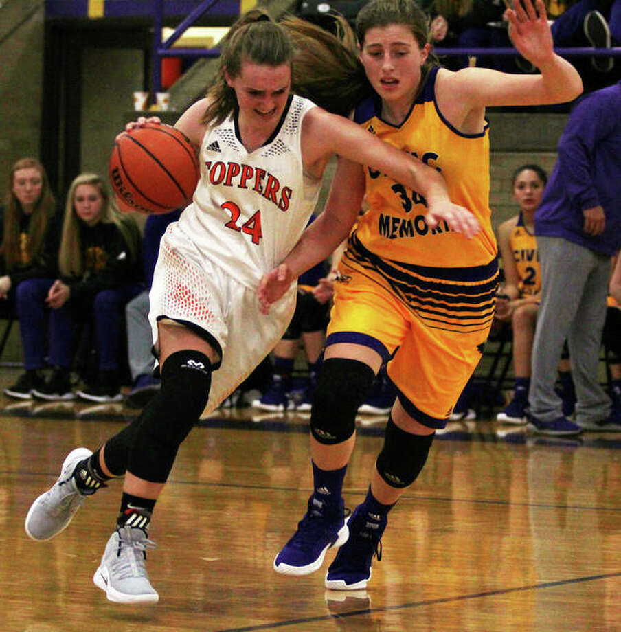 CM's Jackie Woelfel (right) tries to prevent Hillsboro's Sammi Matoush from beating the Eagles' press during the season opener for both teams last Friday at the Taylorville Tournament. Photo: Greg Shashack / The Telegraph