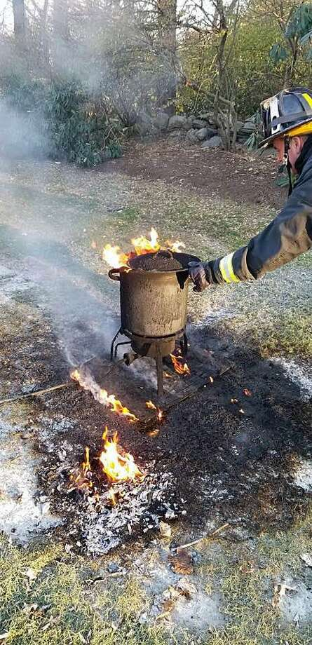 Westport, Conn., firefighters put out a turkey fryer fire on Thanksgiving, Nov. 22, 2018. Photo: Contributed Photo / Westport Fire Department / Contributed Photo / Connecticut Post Contributed