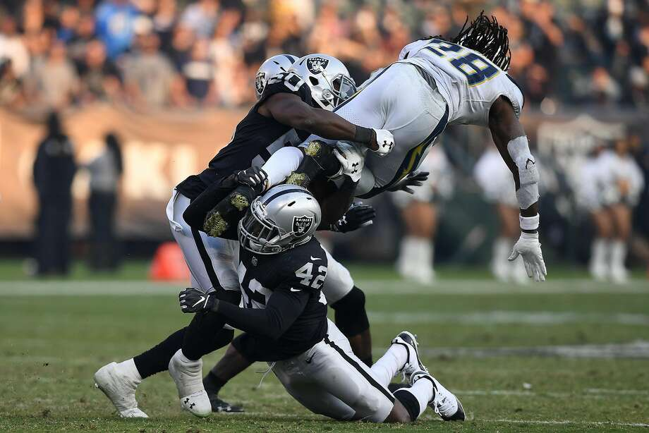Safety Karl Joseph (42) gets in on the tackle as the Raiders bring down the Chargers' Melvin Gordon on Nov. 11. Joseph was a starter last season, but things changed early in this season. Photo: Thearon W. Henderson / Getty Images