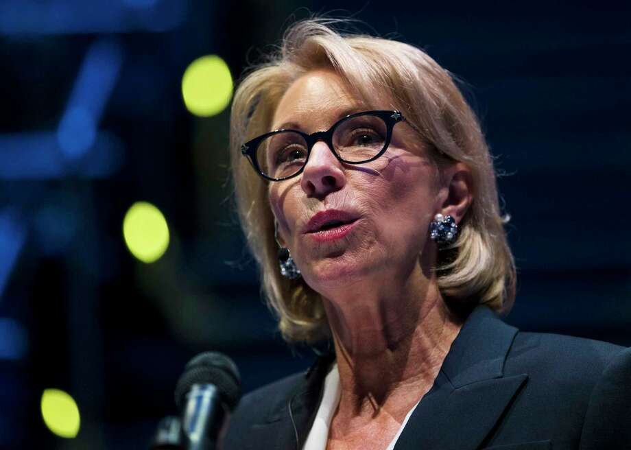 In this Sept. 17, 2018 photo, Education Secretary Betsy DeVos speaks during a student town hall at National Constitution Center in Philadelphia. DeVos is proposing a major overhaul to the way colleges handle complaints of sexual misconduct. The Education Department released a plan Friday that would require schools to investigate sexual assault and harassment only if it was reported to certain campus officials and only if it occurred on campus or other areas overseen by the school. (AP Photo/Matt Rourke) Photo: Matt Rourke / Copyright 2018 The Associated Press. All rights reserved.