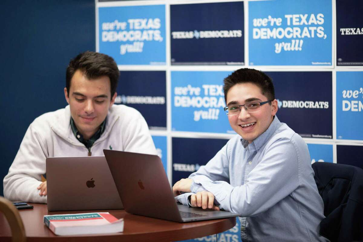 Jared Hrebenar (left) and Ali Zaidi, 19-year-old sophomores at UT Austin, work on a digital plan at the Texas Democratic Party Headquarters Monday, Nov. 19, 2018 in Austin.