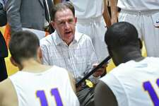 UAlbany Head Coach Will Brown talks to his players at a timeout during a basketball game against Boston University at SEFCU Arena on Wednesday, Nov. 14, 2018 in Albany, N.Y. (Lori Van Buren/Times Union)