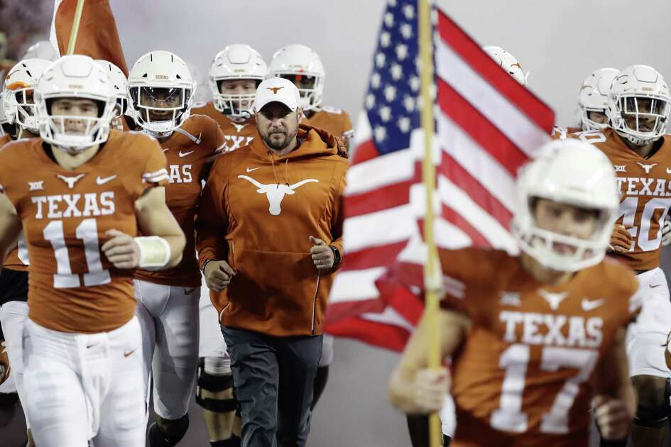 Texas head coach Tom Herman, center, takes the Longhorns to Kansas with a berth in the Big 12 championship game at stake. The last time the Longhorns went to Lawrence they lost in overtime.