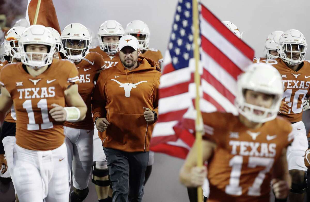 Texas head coach Tom Herman, center, before an NCAA college football game against Iowa State , Saturday, Nov. 17, 2018, in Austin, Texas. (AP Photo/Eric Gay)