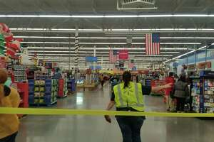Walmart in Latham closed off aisles and cordoned off the space near cash registers to enhance crowds would be calm and orderly during its Thanksgiving evening preview of Black Friday bargains.