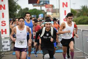 Community members participate in the Junior Hands Across South Texas 5K on Thursday.