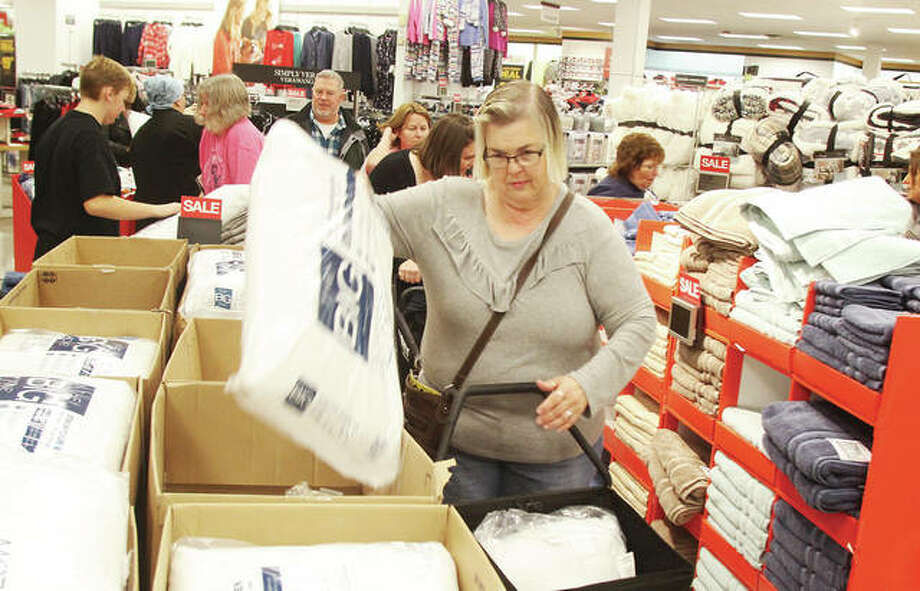 "Barb Loy, of Alton, picks out pillows on sale during ""Gray Thursday"" at Kohl's in Alton. Long lines of customers were there for the Thanksgiving day opening of Kohl's, Target and JC Penney. An estimated 36 million people took advantage of Thanksgiving day sales. Photo: Scott Cousins