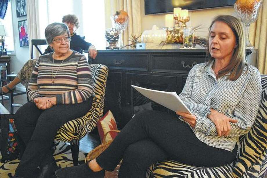 Sorosis Club President Darlene Nelson listens as member Samantha Boston presents her paper on the topic of 19th century women's authors. Photo: Nick Draper | Journal-Courier