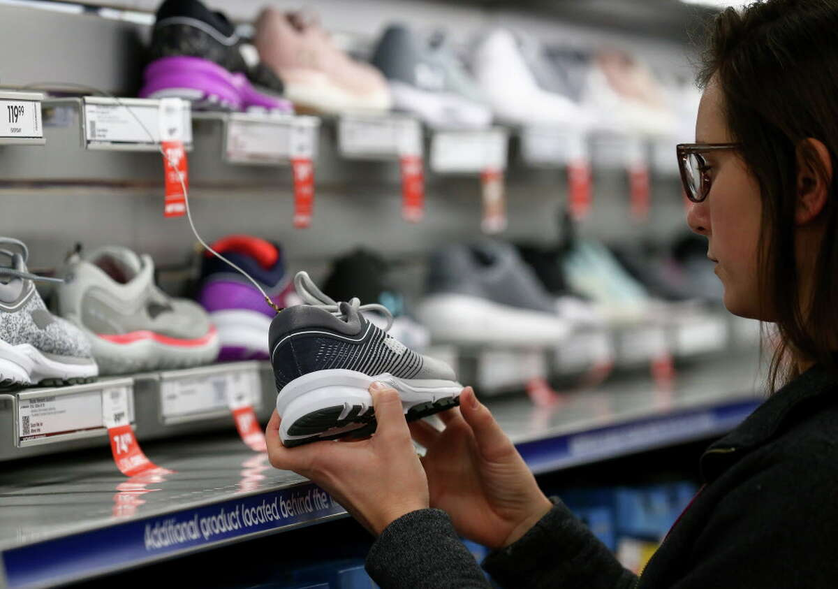 Madison Goolsby, 22, shops for shoes at the Academy Sports + Outdoors store during Black Friday Friday, Nov. 23, 2018, in Spring, Texas. Goolsby left Bryan, Texas around 1 a.m. today to arrive around 2 a.m. at the Cypress outlets.