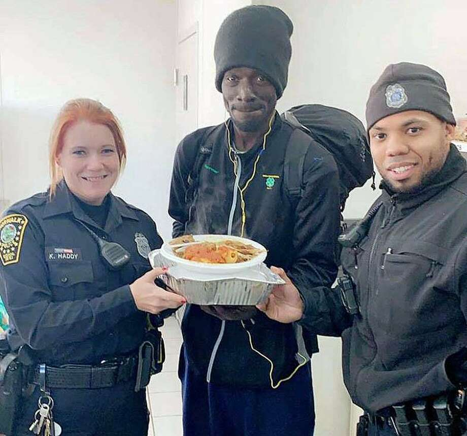 """On Thanksging Day, Nov. 22, 2018, Officers Kelly Haddy and Ariel Martinez responded to a trespassing complaint. The found this gentleman warming up inside the location. Instead of arresting him, they escorted him from the business and then got him Thanksgiving Dinner. Great work by two of Norwalk's Finest."""" Photo: Norwalk Police Department /Facebook"""