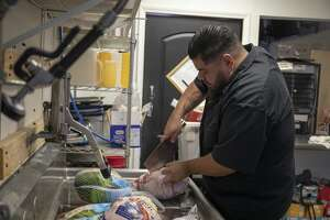 Alejandro Barrientos prepares for Curbside Bistros Thanksgiving meal Wednesday. 11/16/2018  Jacy Lewis/191 News