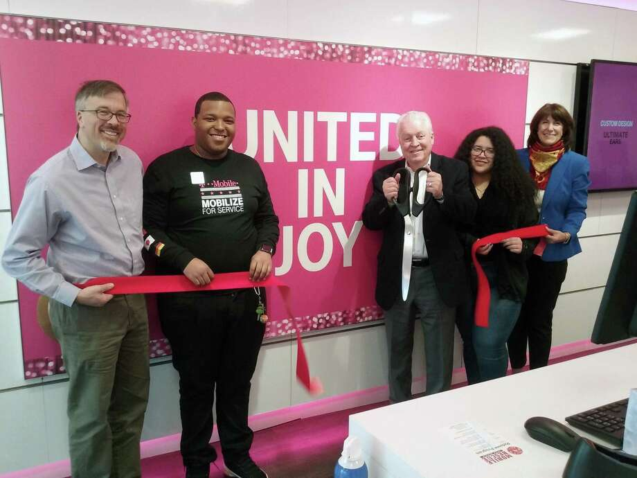 A ribbon-cutting ceremony for the new T-Mobile store at 525 Tunxis Hill Cut-Off in Fairfield was held on Nov. 16. From left, Community & Economic Development Director Mark Barnhart, mobile expert Richard Carberry, First Selectman Michael Tetreau, mobile expert Maria Rivera and Fairfield Chamber of Commerce President Beverly Balaz. Photo: Contributed Photo