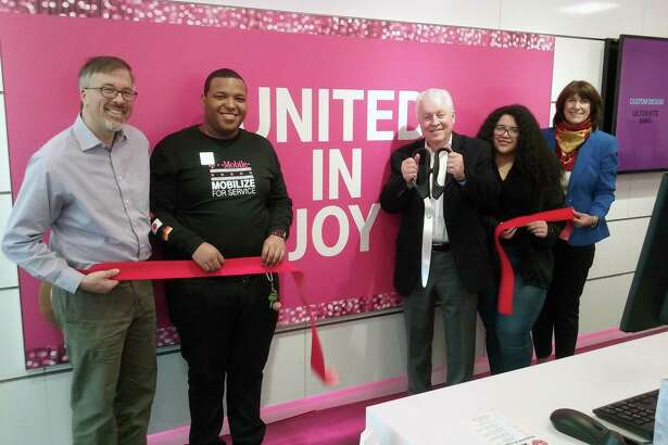 A ribbon-cutting ceremony for the new T-Mobile store at 525 Tunxis Hill Cut-Off in Fairfield was held on Nov. 16. From left, Community & Economic Development Director Mark Barnhart, mobile expert Richard Carberry, First Selectman Michael Tetreau, mobile expert Maria Rivera and Fairfield Chamber of Commerce President Beverly Balaz.