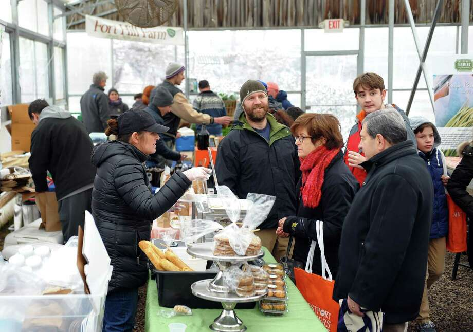 "With a new ""cottage food"" law in effect, Connecticut residents can now sell legally non-perishable foods prepared and packaged in their home kitchens, though with distribution limited to direct delivery or farmers markets like the Westport Winter Farmers Market, pictured. Photo: Christian Abraham / Hearst Connecticut Media / Connecticut Post"