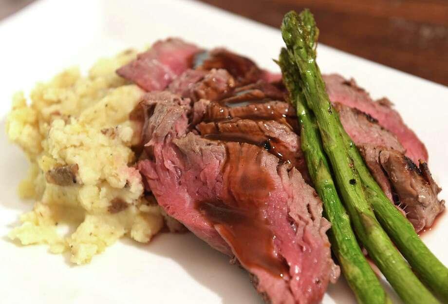 Sliced beef tenderloin, mashed potato, asparagus at Dyad Wine Bar on Tuesday, Nov. 13, 2018 in Kinderhook, N.Y. (Lori Van Buren/Times Union) Photo: Lori Van Buren / 20045449A