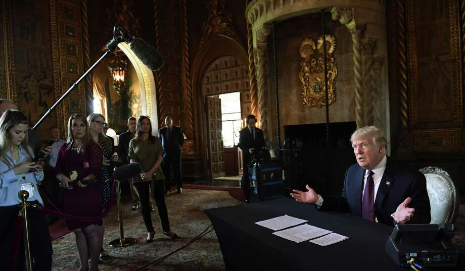 President Donald Trump speaks with reporters at his Mar-a-Lago estate in Palm Beach, Fla., Thursday, Nov. 22, 2018. (AP Photo/Susan Walsh) Photo: Susan Walsh, STF / Associated Press / Copyright 2018 The Associated Press. All rights reserved.