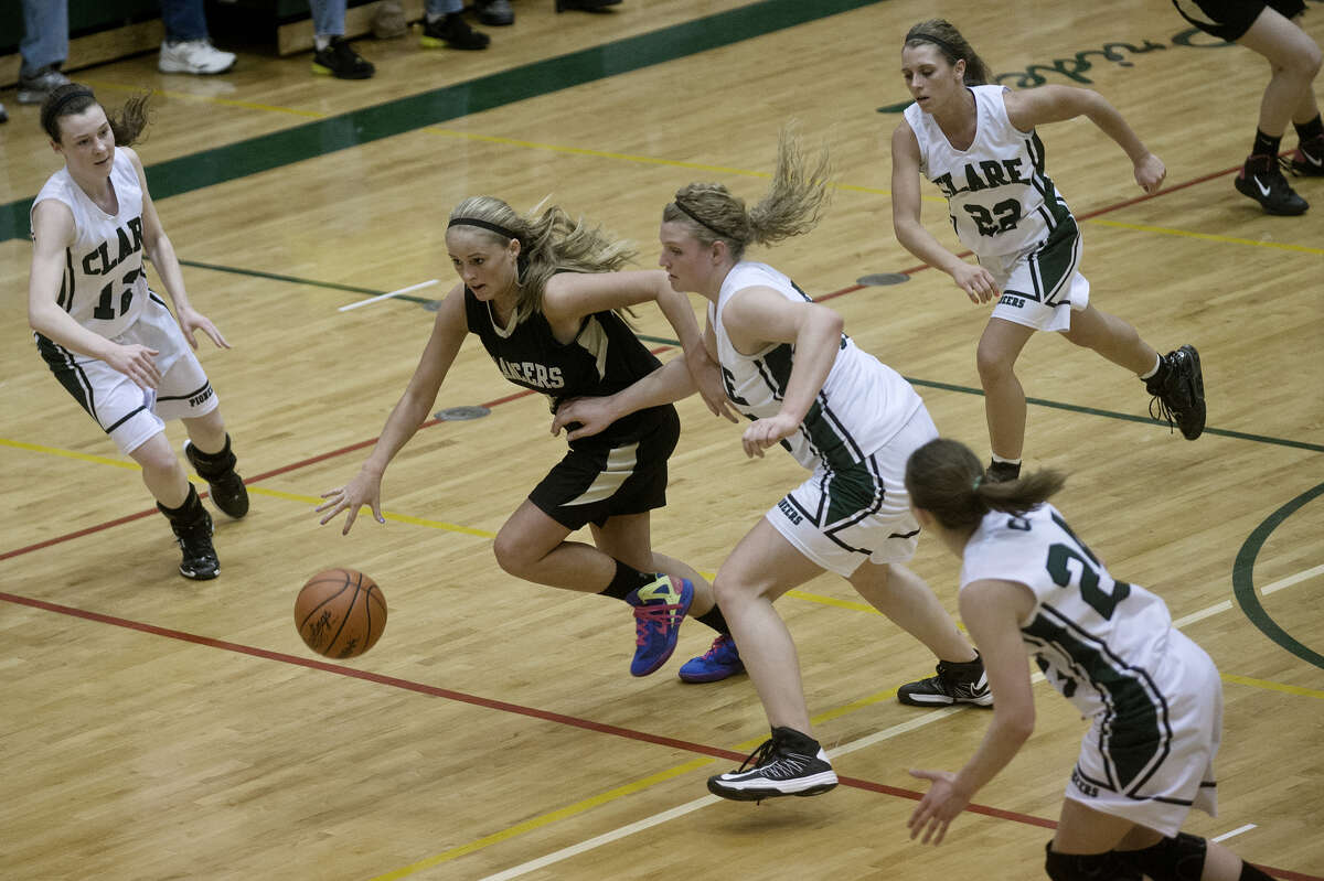 Bullock Creek's Ellie Juengel pushes the ball upcourt against Clare during a March 12, 2013 Class B quarterfinal at Houghton Lake High School.