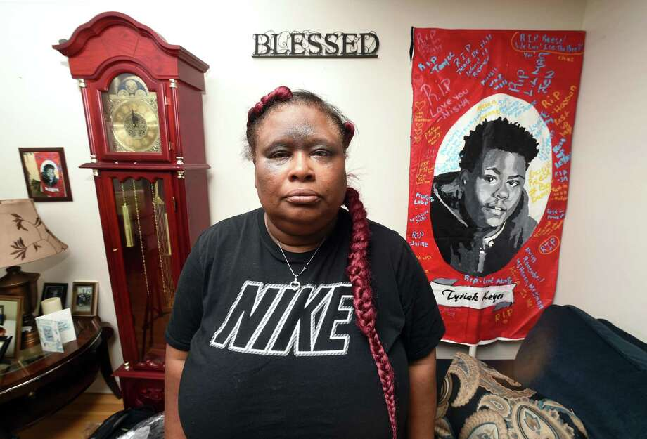 Demethra Telford, mother of Tyrick Keyes, is photographed at her home in New Haven on July 3, 2018. Hanging on the wall at right is a picture of her son who was shot and killed on July 16, 2017. Photo: Arnold Gold / Hearst Connecticut Media / New Haven Register