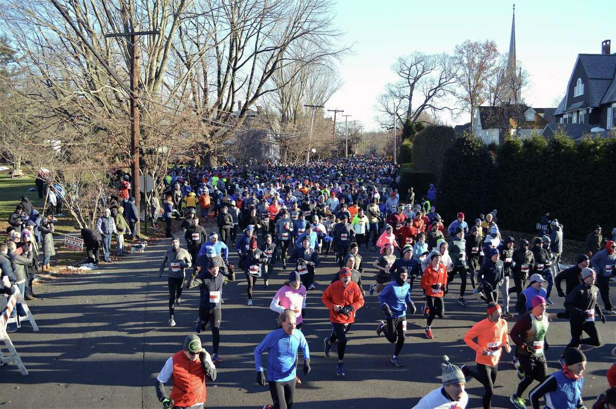Thousands of runners set out west on Pequot Avenue at the start of the Pequot Runners' 41st annual Thanksgiving Day Road Race, Thursday, Nov. 22, 2018, in Fairfield, Conn.