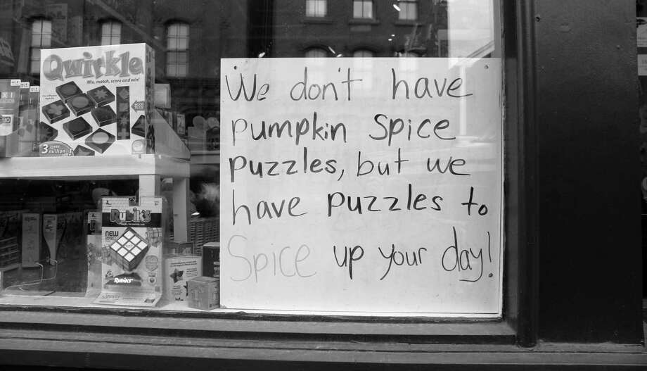 A witty poster hangs outside Age of Reason toy store in Westport on Nov. 19. Photo: Sophie Vaughan / Hearst Connecticut Media / Westport News