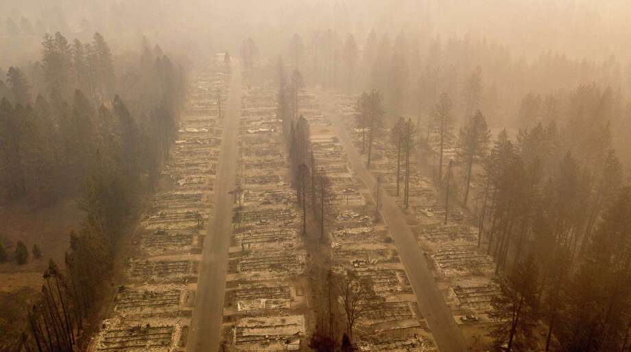 (FILES) In this file photo taken on November 15, 2018 In this aerial photo, a burned neighborhood is seen in Paradise, California. - The fire that has ravaged northern California is now almost completely contained, authorities said on November 22, 2018, as the death toll rose to 84. The number of people listed as unaccounted for in the deadliest and most destructive fire in state history stands at 563. (Photo by Josh Edelson / AFP)JOSH EDELSON/AFP/Getty Images Photo: JOSH EDELSON, Contributor / AFP/Getty Images / AFP or licensors