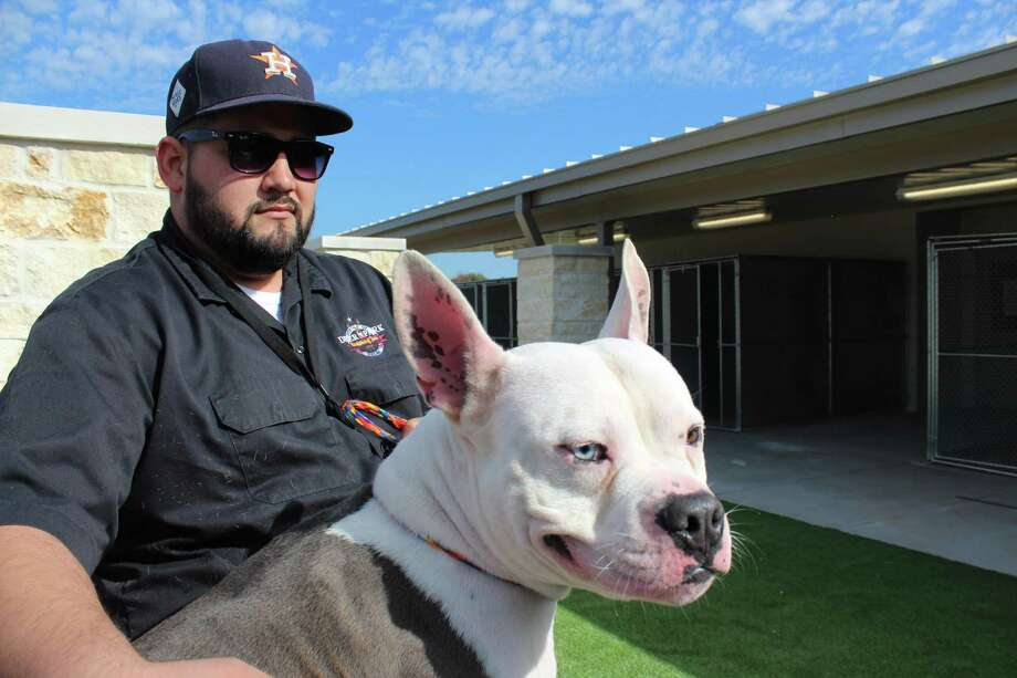 Deer Park animal shelter supervisor Al Garces takes a walk with Rhino, a dog kept at the facility, to check on construction progress for a new shelter building.