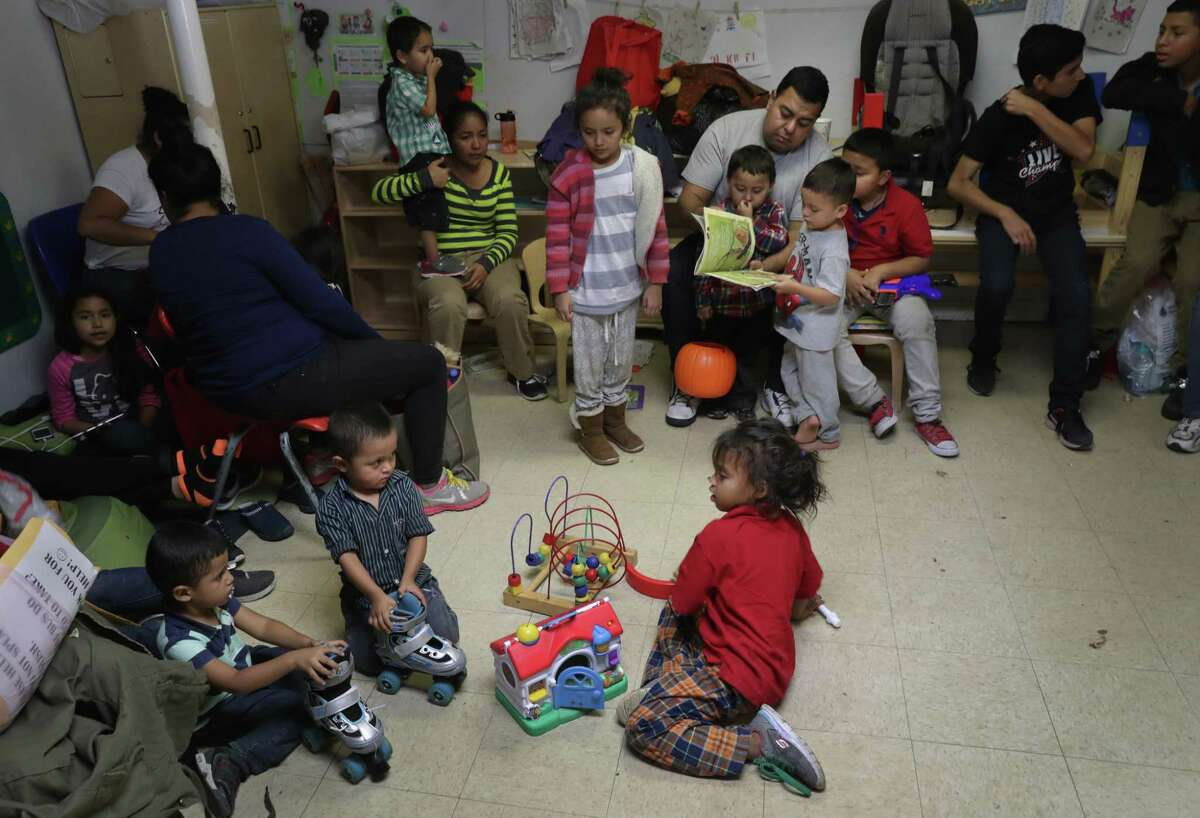 Immigrant children read and play at a Catholic Charities shelter after being released from U.S. government detention on Nov. 3 in McAllen. The number of mostly Central American children coming here alone has largely stayed steady, about 5,000 in October. The number offamilies coming here together however has skyrocketed to a record 23,121 last month.