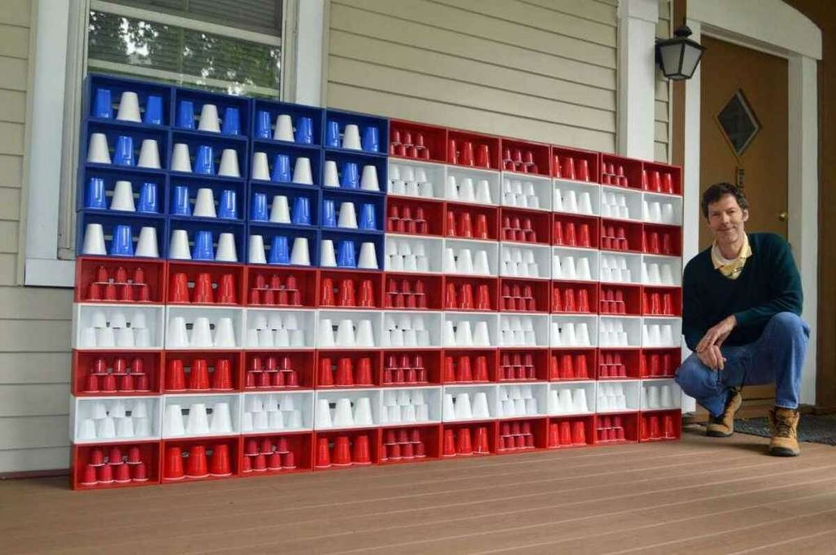 Artist and actor Robert Carley appears obsessed with Old Glory.